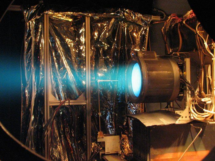 The eerie blue exhaust trail of an ion thruster during a test firing. A quartet of these highly efficient T6 thrusters is being installed on ESA's BepiColombo spacecraft to Mercury at ESA's ESTEC Test Centre in Noordwijk, the Netherlands.