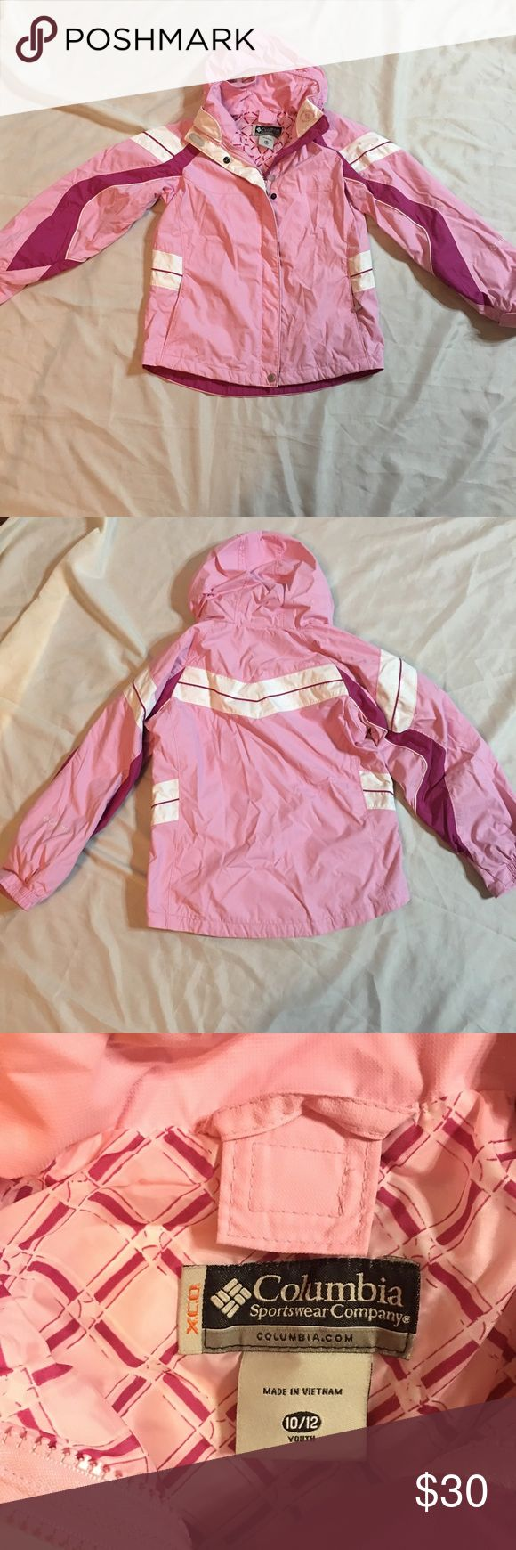 Columbia Sportswear Waterproof Youth Coat 10-12 Super nice Columbia Sportswear girls coat!  Size 10-12. There are a few smudges that could be cleaned but I have well water and it stains. Zips and snaps up front. Has a good that you can fold up inside the coat. Columbia Jackets & Coats Raincoats