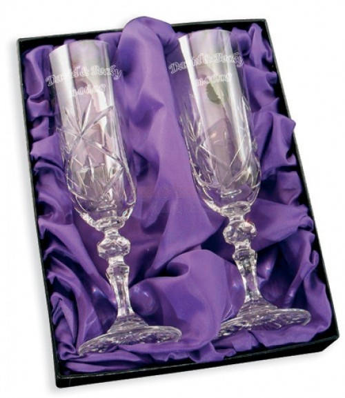 Our Personalised Cut Crystal Champagne Flutes is the perfect accompaniment to any special occasion that calls for a Champagne toast.    Made of 24% genuine lead crystal, this cut glass set was made for celebrating. In addition to weddings, milestone anniversaries and birthdays, the Crystal Flutes are just right for gifting the Happy Couple.    Each flute can be personalised with ANY Message to fit the occasion, and will make the flutes an even more special gift to your recipient! £34.95