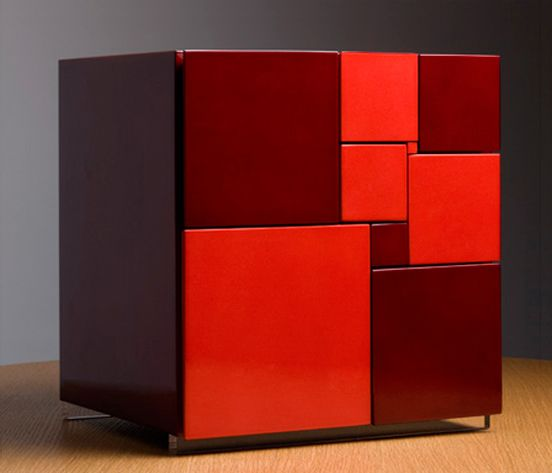 cabinet by Japanese architect and designer Nosigner.  Each of the 9 drawers is faced with a perfect square.