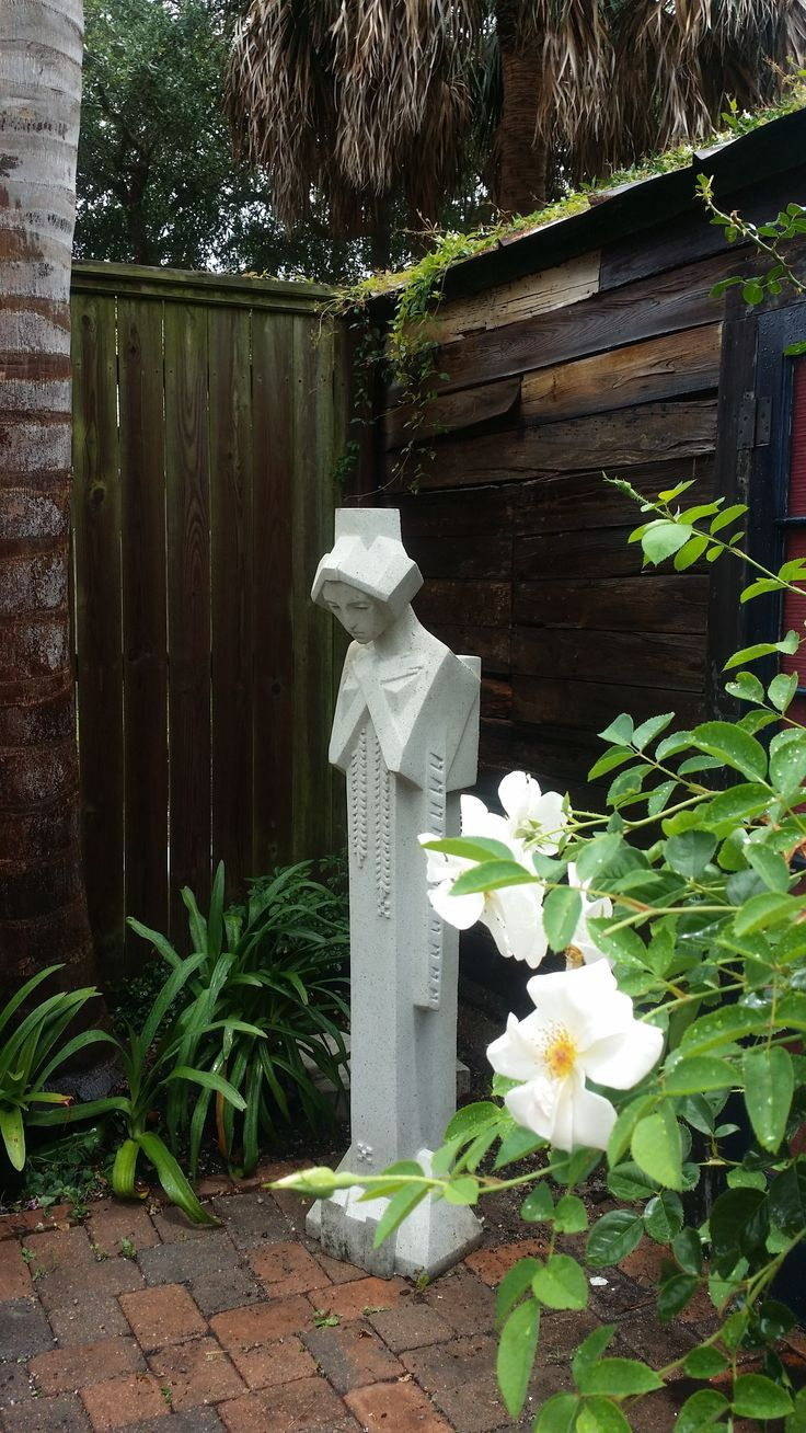White roses compliment the artistic style of the Midway Gardens Sprite sculpture. [ TheGardenFountainStore.com ]