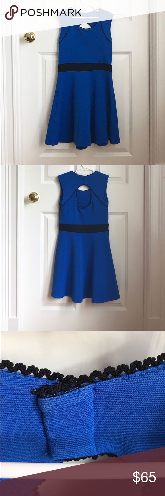 Royal Blue Sally Miller Girls Dress Really cute Sally Miller royal blue dress for girls in size L (12). It has a cute cut out in the back! This dress is in great condition and is made of 95% polyester and 5% spandex. It has been seemed at the neckline but it can easily be taken out! This dress is no longer in stores or online. Sally Miller Dresses