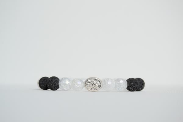 8mm essential oil diffuser braceletHow does it work?Dab your favorite essential oil onto the lava bead(s) found on your handcrafted piece. The oil will soak into the lava and diffuse for hours to come!This bracelet is made of cracked quartz that has an iridescent coating& black lava beads. Features a silverSt MichaelMedal. Strung on a thick, sturdy elastic cord.Please note the pictures that coincide with the size. Because of the number of beads needed to create certain sizes, patt...