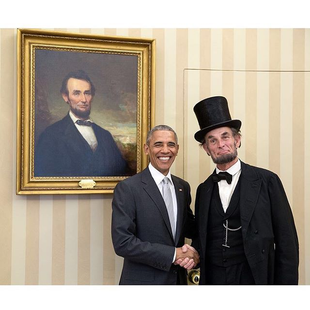 """This one won't make it in my annual Year in Photographs but I thought it was still kind of amusing. Lincoln impersonator Richard """"Fritz"""" Klein was at the White House for a special program so the President invited him to stop by the Oval Office."""