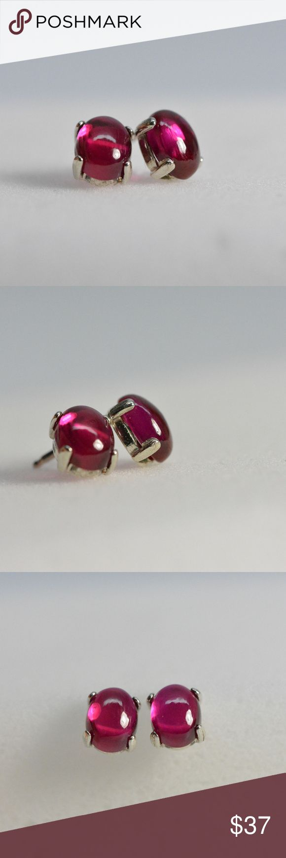 Ruby earrings stud - sterling silver Cabochon Stunning red/pink Ruby earring studs set in .925 sterling silver mountings. These Ruby gemstones are synthetic 7X5 cabochons and are absolutely stunning  stud earrings sterling silver Synthetic Ruby Gemstones 7X5 oval cabochon (lab created) Jewelry Earrings
