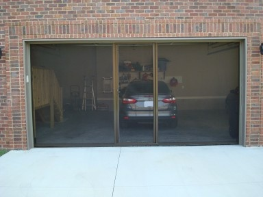 completed projects of garage doors and breezy living screens