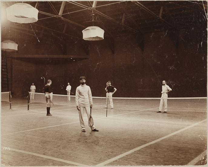 Men Playing Tennis At The Indoor Tennis Courts, Located