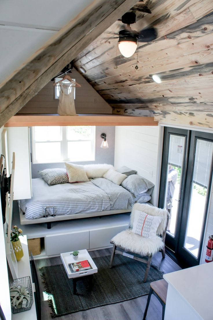 The 28' tiny house features a main floor queen size bedroom, built-in fir desk, and a drop down deck.