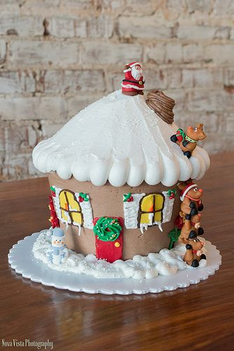 Santa's Helpers (Giant Cupcake) Decorated by Tricia Gray at Honeymoon Bakery.