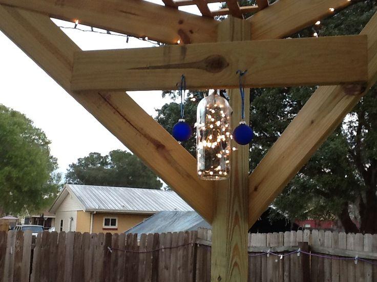 Wine bottle pergola lights pallet bar and purgula for Wine bottle patio lights