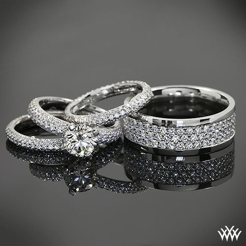 """Diamond dazzled by this powerful pave duo. Love men's bands that aren't afraid to rock a few """"ROCKS""""!    Delightful Details   2 Lady's Platinum Full Eternity Wedding Bands  0.75ctw Bead-Set Whiteflash ACA diamond melee    Men's Platinum Full Eternity Wedding band  Approximately 2ctw Bead-Set Whiteflash ACA melee    Diamond Engagement Ring - 0.60ctw ACA melee  1.143 G SI1 Whiteflash ACA Hearts and Arrows Diamond"""