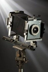 The Arca-Swiss 4x5 inch view camera  used a half-century ago by photographer and environmentalist Ansel Adams will be offered Oct. 27, 2016, in a public auction in New York City by Heritage Auctions. It was used by Adams for shooting the well-known 1968 image Arches, North Court, Mission San Xavier Del Bac in Tucson, Arizona and other famous photographs.