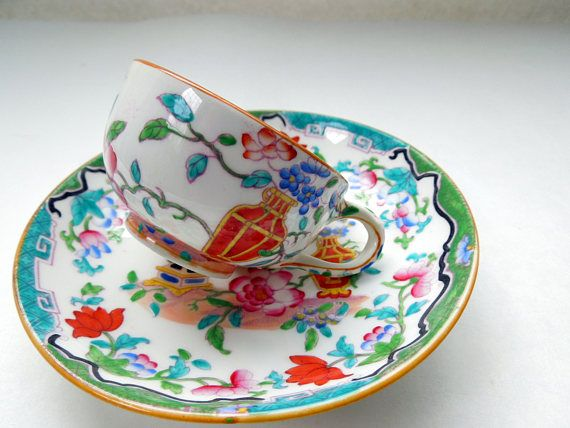 Rare Antique Minton Demitasse Cup and Saucer decorated with Enamel Polychrome Colors depicting Flowers in Pink, Turquoise, Red. Rare Oriental Pattern. England, 1862- 1871. Fine English 19th Century China.