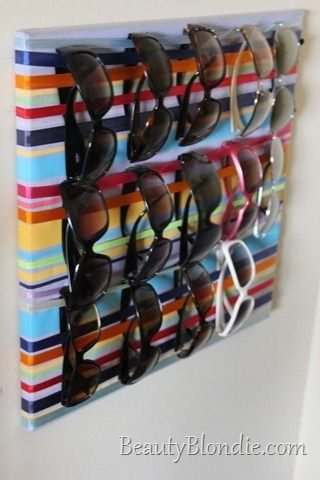 Summer is coming! Get your sunnies ready. Here are our favorite sunglass-storage hacks on the Web. 1. Wooden Bungee Wall Organizer - A Snug Favorite! 	   	 Shopping list:  	 – bungee cords (red, yellow, blue) 	 – wood stain (golden pecan, jacobean, sedona red) 	 – 3 2-foot hobby boards 	 – pictur...