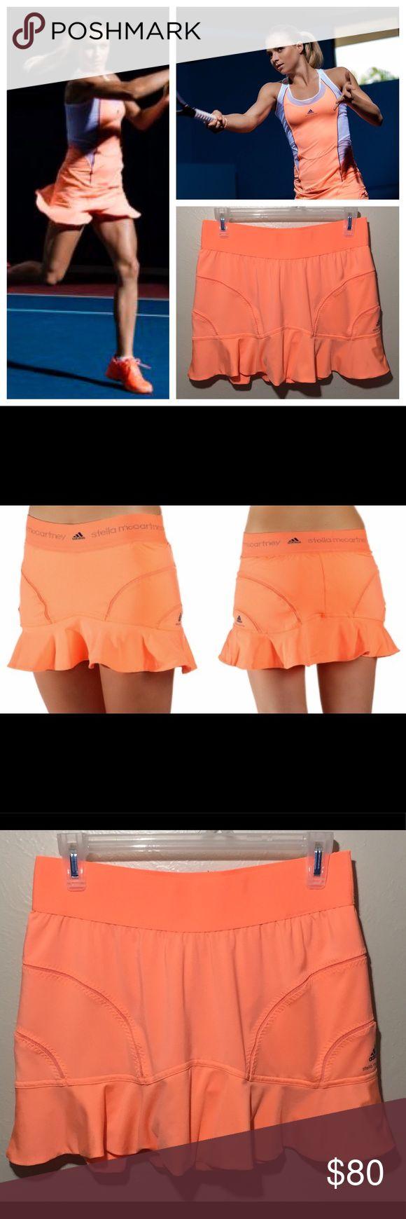 "Stella McCartney Adidas Barricade Skirt Skort Stella McCartney Adidas Barricade Bright Coral Tennis Skirt Skort.  Please view last photo for minor elastic stretch.  MEASUREMENTS: ACROSS WAIST: 14"" TOTAL LENGTH: 14"" Adidas by Stella McCartney Skirts"