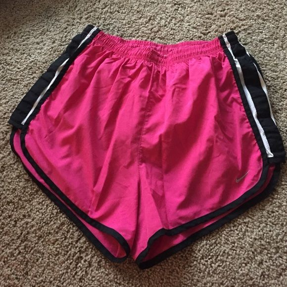 NWOT Nike Running Shorts NWOT Nike Running Shorts!! Only worn a couple times, great condition!! Bright pink with black piping! Nike Shorts