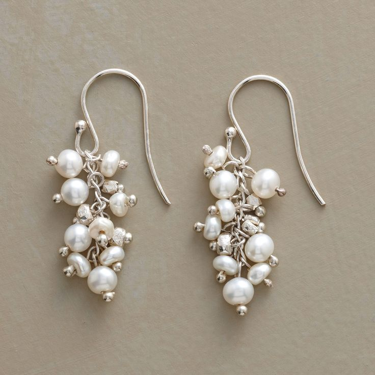 """COMPETITIVE PEARL EARRINGS -- These handmade dangling pearl earrings feature cultured freshwater pearls jostling for attention, each hoping to stand out in the crowd. Sundance exclusive. Made in USA with sterling silver beads and French wires. 1-1/4""""L."""