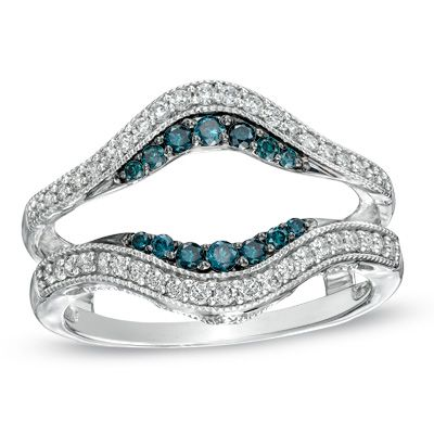 thinking of something like this for my wedding band...only hopefully I can find one that isn't $999, maybe with sapphires instead of blue diamonds.