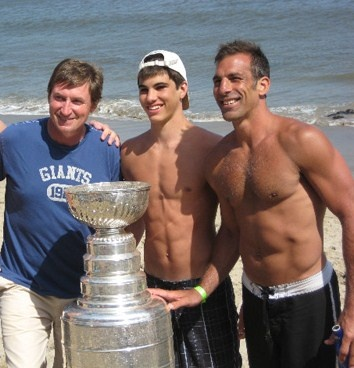 Chris Chelios on the right in 2009 at the age of 45...I'm assuming that's his son Jake cause damn