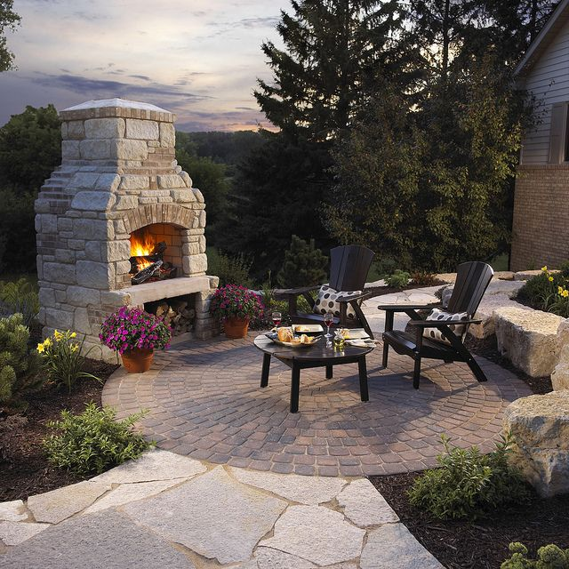 Backyard retreat Outdoor Fireplace and Circle Patio by Winco Landscape and Design on Flickr