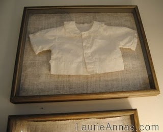 Framed baby clothes