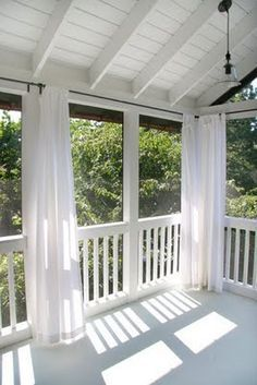 back porch with curtains...would be great to block a setting sun or as a misquito blocker