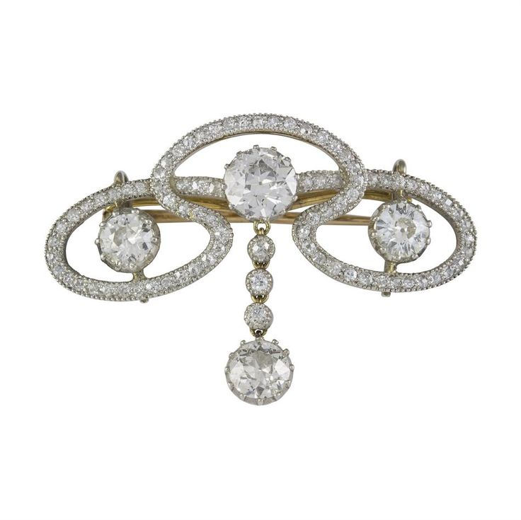 An Edwardian diamond scroll brooch