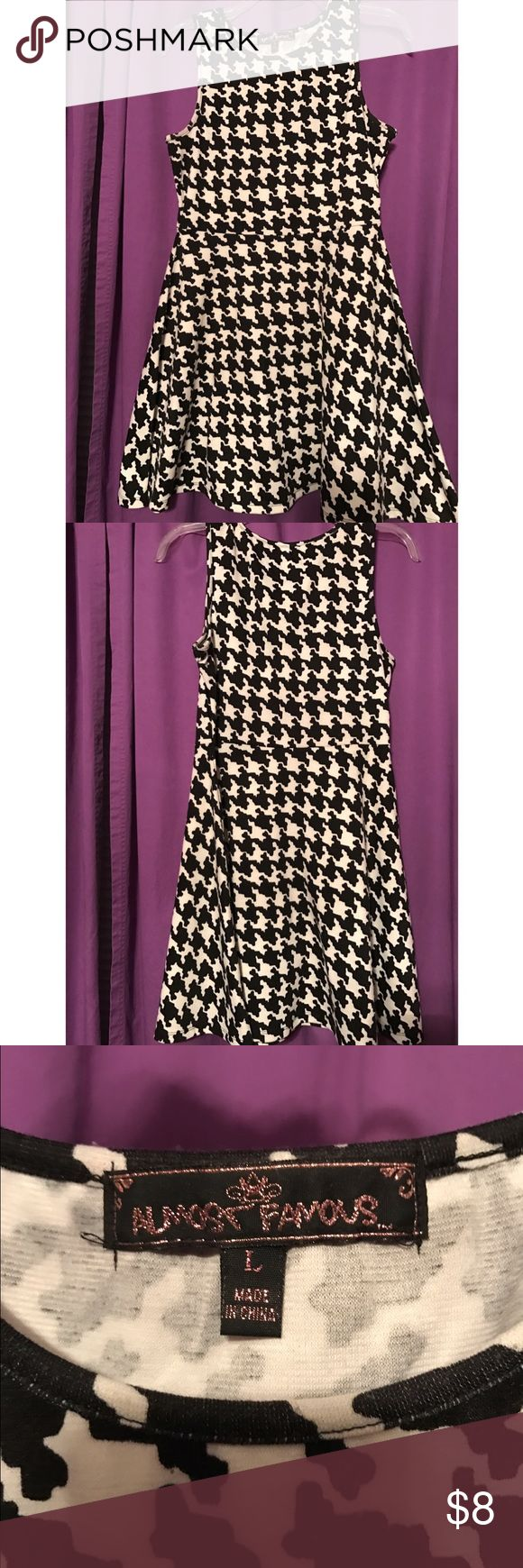 Black and white cocktail dress Fitted top half with skater skirt bottom half. Great party dress Almost Famous Dresses