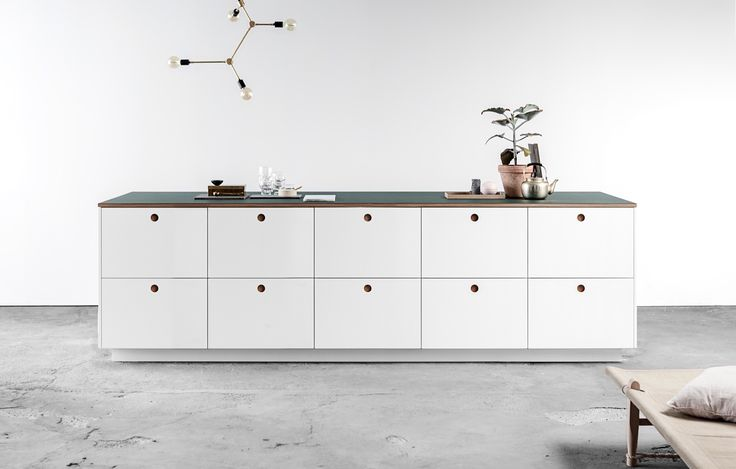 Ikea hack: the Basis kitchen from Reform made with Ikea cabinets and Reform's fronts and counters | Remodelista