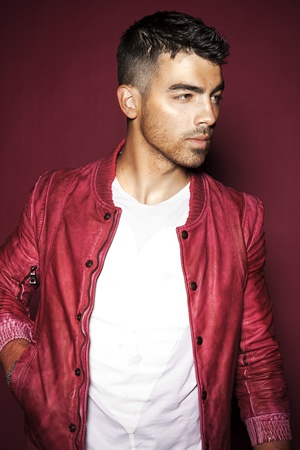 Joe Jonas. Love the jacket and his hair is awesome