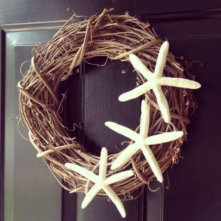 DIY grapevine starfish wreath.