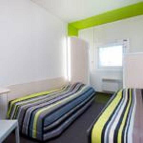 hotelF1 Mulhouse Centre Ouest Mulhouse hotelF1 Mulhouse Centre Ouest is located in Mulhouse, 1.7 km from Parc Expo Mulhouse and 4 km from Mulhouse Hospital .  Each room is fitted with a shared bathroom.  Mulhouse Christmas Market is 1.