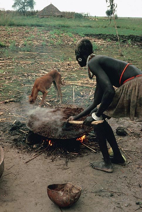 Africa | Nuer woman cooking Sorghum Beer.  Sudan | ©Digital Library University of Wisconsin--Madison. African Studies Program. Photographer Sharon Hutchinson