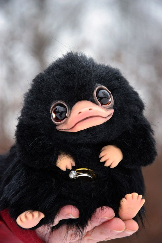 Niffler from Fantastic Beasts and Where to Find Them. Ring (the on that in the pocket) is not included. Approx 15 cm ( ~6) in length. - Completely handmade. - Solid parts are made of polymer clay. - Glass eyes. - Fully Posable. Wire skeleton. - Made from high quality Faux Fur.  This is a collectors item and made for adults only. Will not be suitable for children. Can not be washed.  ATTENTION! This is made to order toy! I dont have this creature in stock right now! It will take several weeks…