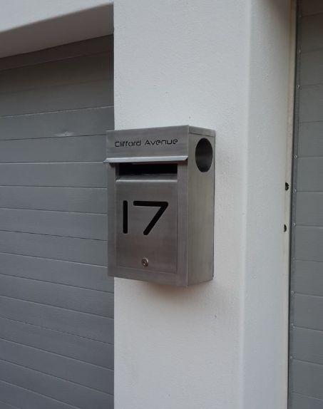 External Portrait Stainless Steel Letterbox with cut-out text in the door panel and backed with black perspex. Includes a built in News Paper tube. Grade 316 stainless steel with brushed finish.
