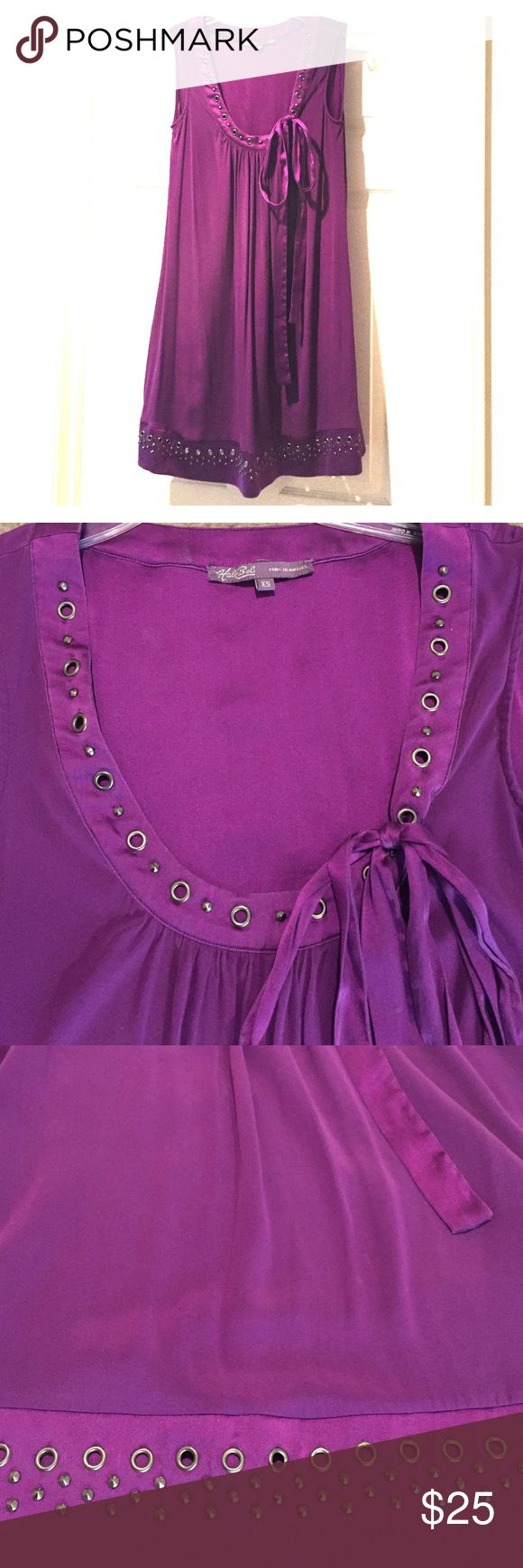 Hale Bob Dress Purple dress with crew neck and bottom trim decorated with grommets and studs on the front for a stylish look. No decoration on the back. 94% silk and 5% spandex. Loose fit. Used and in great condition. Hale Bob Dresses