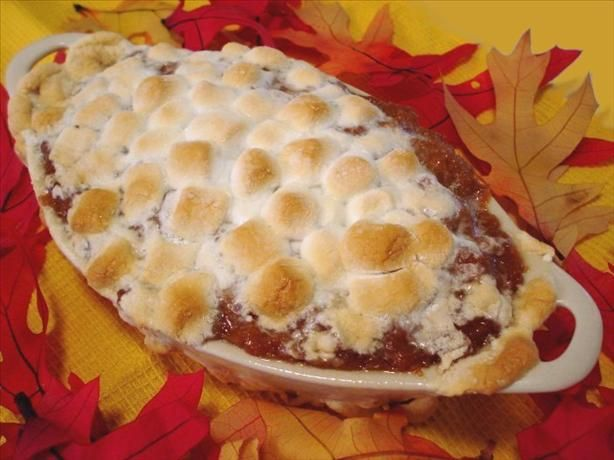 Easy Sweet Potato Casserole With Marshmallows (made with canned yams).  My Great Aunt used to make a recipe similar to this - awesome. =)