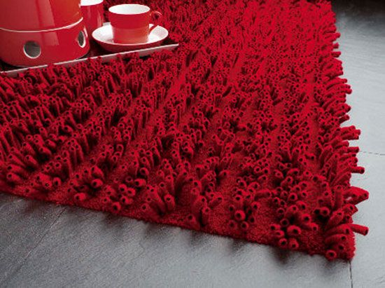 """This unique rug design comes from by JAB Anstoetz and is made from merino wool, having a soft and inviting look. The yarn was transformed into a cool and playful tubular configuration. The innovative """"tubes"""" are placed on a solid and resistant base. Lasa Carpet is available in five colors"""