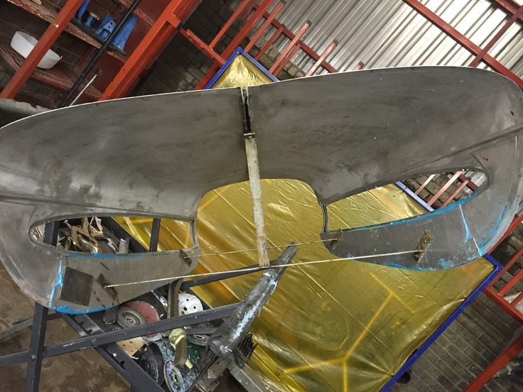View of aluminium bonnet from underneath with strengthening plates in place.