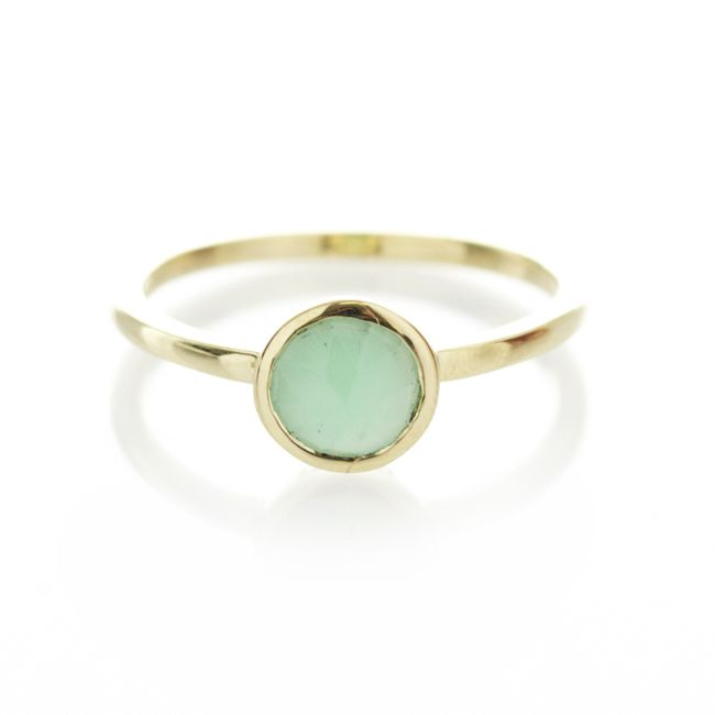 A 9ct yellow gold ring, with centered Chrysoprase gemstone.  When ordering one of our gold luxury rings please provide us with your exact ring size. This can be done in thecomment box once your order has been placed.   To find out more about ring sizes please visit the information page on the menu above.   Our luxury gold rings are only available to ship within South Africa.
