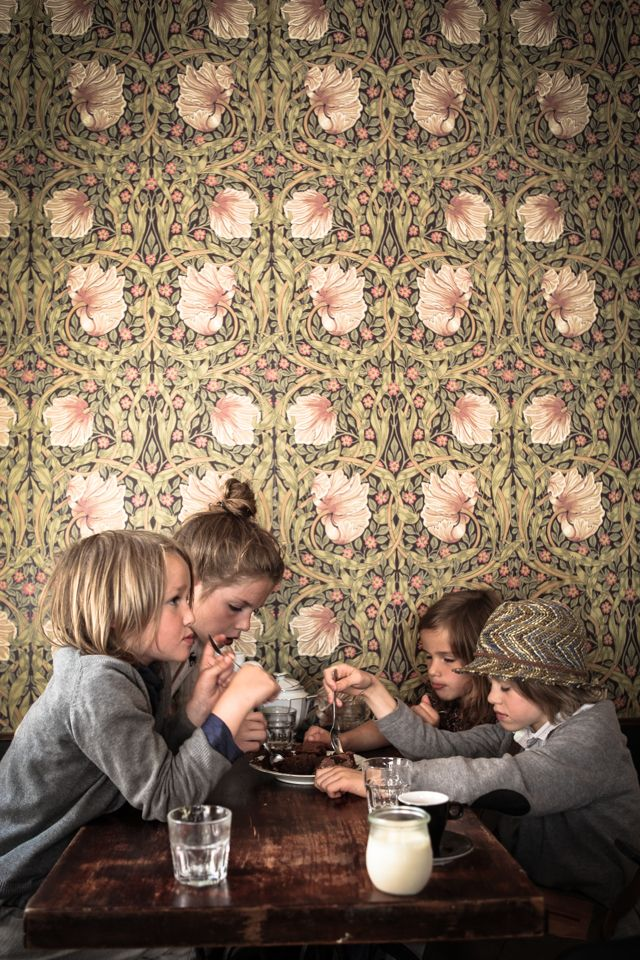 What a great ambiance this wallpaper gives to this eating area.