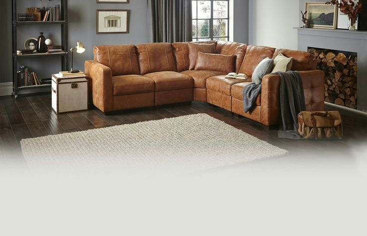 Tan sofa on grey wall