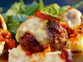 Italian Meatball Sliders with Red Sauce : These classic meatballs are made with both ground beef and ground pork to get a balance of lean and fatty meats. Coat the meatballs in a simple red sauce and serve them on sweet Hawaiian buns.