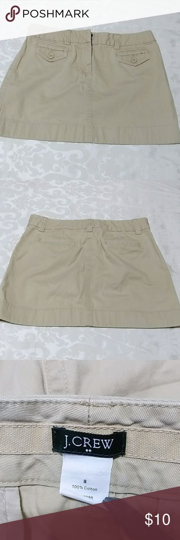 J. Crew mini skirt S-34 Khaki fabric  Tan color Coffee stain before the hem not noticeable see the last picture aside from that everything is Good condition.   Measurements laying flat  Waistline 16 inches Length 14 inches J. Crew Skirts Mini