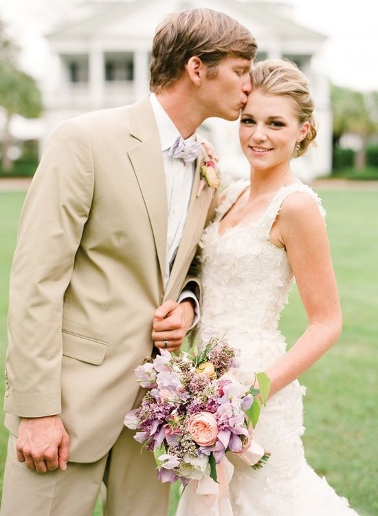 groom wearing khaki suit   bow tie
