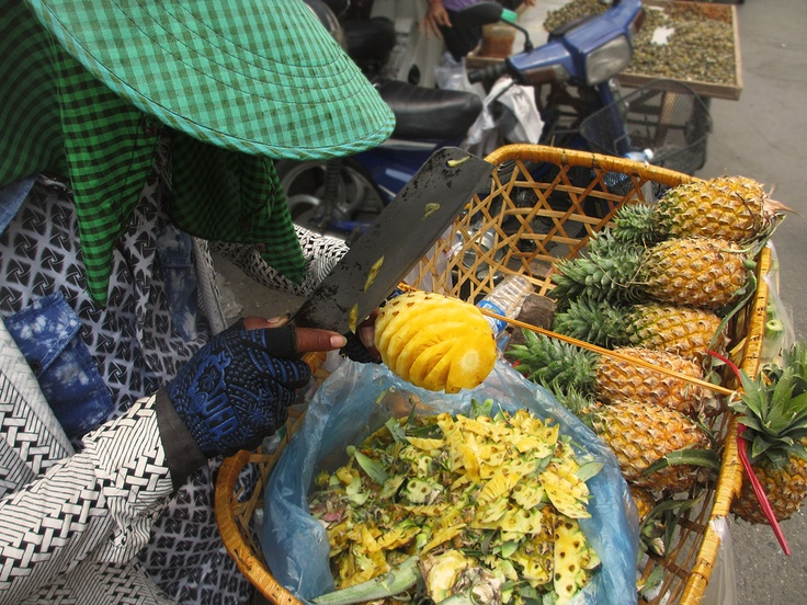 Fresh pineapples are sold in Cambodia for around 2000 riels each (50 cents / 30 pence)