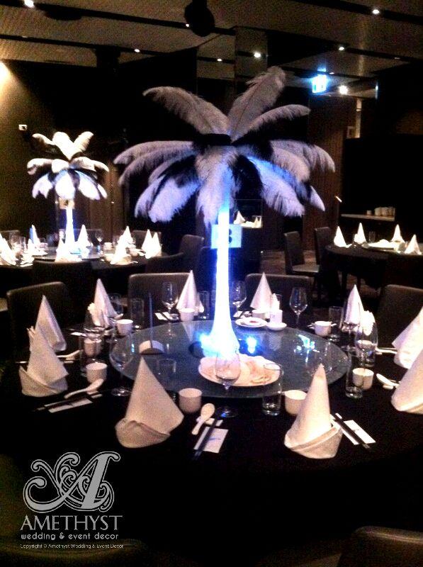 Black white feather centerpieces on eiffel vase