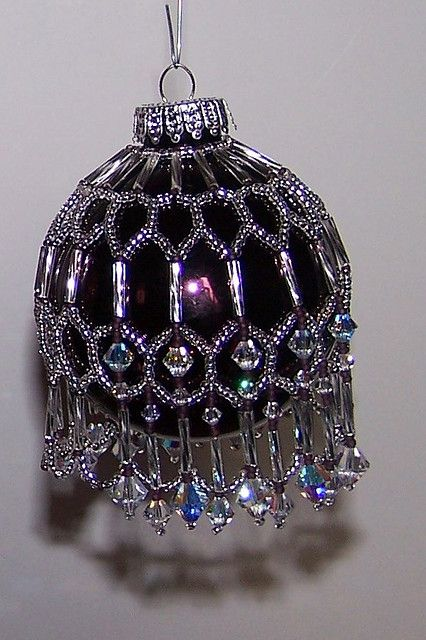 My favorite ornament cover. I used twisted silver bugles and lots of swarovski crystals.