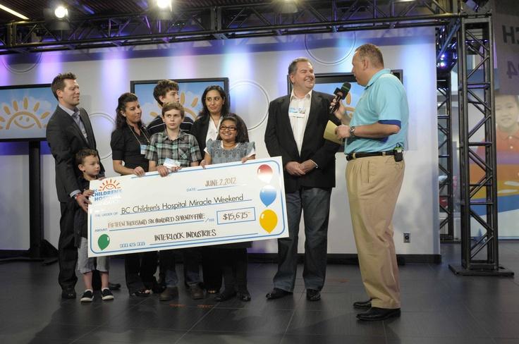 2012 - Interlock Industries (BC) Ltd. donates a check to the BC Children's Hospital Foundation.