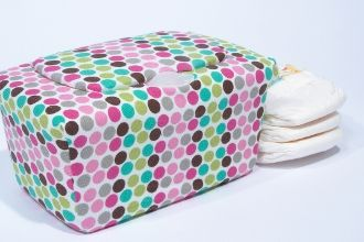 LOVE these baby wipe box covers!   Found them on cleverrelish.com....they have a great selection of patterns and they look totally cute!